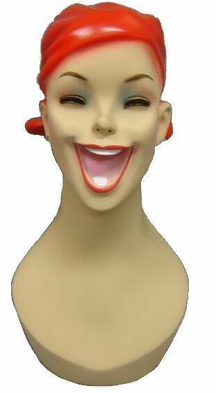 http://buystoreshelving.com/female_head_displays/laughing_cartoon_female_red_hair.jpg